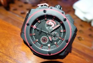The 48 mm fake Hublot King Power 701.CI.1123.GR watches have black dials with red elements.